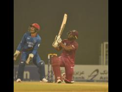 Opener Evin Lewis (right) smashes a big six during his 68 off 41 balls during the Windies 30-run win over Afghanistan in their Twenty20 International match at the Atal Bihari Vajpayee International Stadium in Lucknow, India, on November 14, 2019. yesterday.