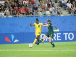 Jamaica's Jody Brown (left)  shielding the ball from  Australia's Karly Roestbakken during last year's FIFA Women's World Cup in France.