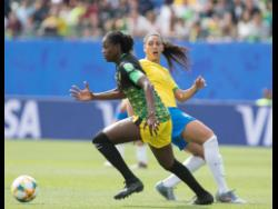 Konya Plummer (left) dribbles past Brazil's Beatriz Zaneratto Joao during their first-round encounter at the 2019 FIFA Women's World Cup.