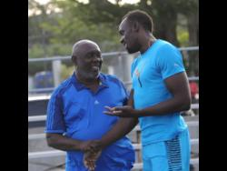 Usain Bolt (right) and former coach Glen Mills.