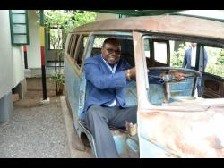 In this 2017 photo, tourism minister Edmund Bartlett 'takes a spin' in the Volkswagen bus that belonged to late reggae icon, Bob Marley, which is on the grounds of the Trench Town Culture Yard Museum in St Andrew.