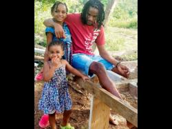 Recording artiste Lee Dann and his daughters.