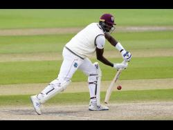 West Indies captain Jason Holder bats during the last day of the second Test match against England at Old Trafford in Manchester, England, on Monday, July 20.