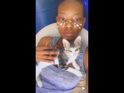 Tavia Bishop and her cat Kookie.