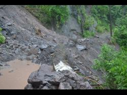 This section of the Gordon Town main road is impassable following landslides.