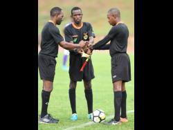 File Photos Referees converge on the touchline at the Stadium East field before a Manning Cup match in 2018.