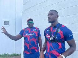 West Indies fast bowler Jayden Seales (right) in conversation with assistant coach Roddy Estwick during a net session in St Lucia.