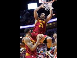 National basketballer Samardo Samuels (top) during his time with the Cleveland Cavaliers in the NBA in 2011.