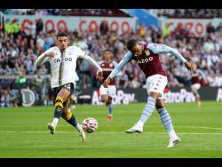 Aston Villa's Leon Bailey (right) scores during the English Premier League match between Aston Villa and Everton at Villa Park, Birmingham, England last Saturday.