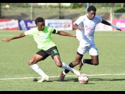Shaquille Bradford (left) of Waterhouse and Mount Pleasant's Ladale Ritchie in a keen tussle for the ball during last Saturday's Jamaica Premier League first leg semi-final match at the UWI-JFF Captain Horace Burrell Centre of Excellence.