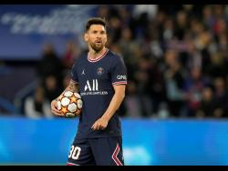 PSG's Lionel Messi prepares to take a penalty to score his side's third goal during the Champions League Group A  match between Paris Saint Germain and RB Leipzig at the Parc des Princes stadium in Paris yesterday.