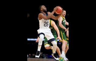 United States' Kemba Walker attempts a shot during their exhibition basketball game against Australia in Melbourne yesterday.
