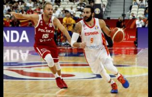 Ricky Rubio of Spain controls the ball over Lukasz Koszarek of Poland during their quarter-final match for the FIBA Basketball World Cup at the Shanghai Oriental Sports Center in Shanghai on Tuesday.