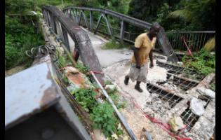 The main bridge that connects  Bowden Hill  and the Airy Castle communities  in St Andrew has been damaged since February. Work started in June to replace the bridge, but residents have complained about the slow pace at which it was progressing.