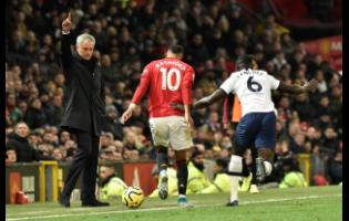 Tottenham manager Jose Mourinho (left) reacts as Manchester United's Marcus Rashford (centre) and Tottenham's Davinson Sanchez battle for the ball during their English Premier League match at Old Trafford in Manchester, England, yesterday.