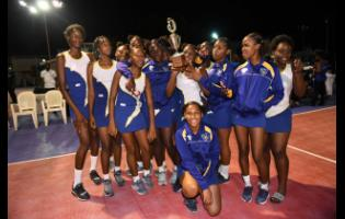 Gaynstead High School netballers pose with the trophy after defeating St Hugh's High School in the ISSA Urban Area Netball Junior final at the Leila Robinson Courts in Kingston, yesterday.