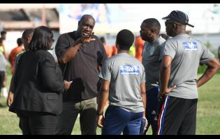 Tivoli and Waterhouse officials in discussion with match commissioner before their Red Stripe Premier League match was called off on December 1.