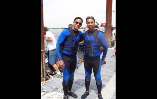 Jamaica-born stuntman Roy T. Anderson (right) with Hollywood megastar Will Smith.