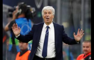 In this  Tuesday, October 1, 2019 file photo, Atalanta coach Gian Piero Gasperini gives instructions during the Champions League Group C match between Atalanta and Shakhtar Donetsk at the San Siro Stadium in Milan, Italy.