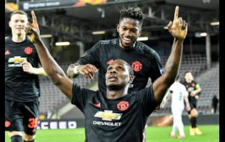 Manchester United's Odion Ighalo celebrates after scoring the opening goal during the Europa League round of 16 first-leg soccer match between Linzer ASK and Manchester United in Linz, Austria, Thursday, March 12, 2020.
