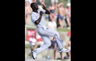 West Indies' Kemar Roach bowls against England during day one of the second Test cricket match at the Sir Vivian Richards Stadium in North Sound, Antigua and Barbuda, Thursday, January 31, 2019.