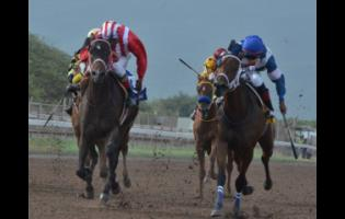 FILE CRYPTOCURRENCY (Ian Spence, left) captures the Titania Trophy over 1100m at Caymanas Park on July 6 last year.