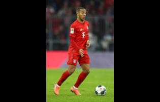 In this  Saturday, November 30, 2019 file photo Bayern's Thiago controls the ball during the German Bundesliga first division match between FC Bayern Munich and Bayer Leverkusen 04 in Munich, Germany.