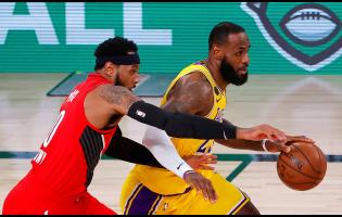 Los Angeles Lakers' LeBron James (right) drives the ball against Portland Trail Blazers'Carmelo Anthony during Game 2 of an NBA  first-round play-off series on Thursday, August 20.