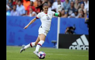 In this July 7, 2019, file photo, United States' Alex Morgan controls the ball during the Women's World Cup final soccer match against The Netherlands at the Stade de Lyon in Decines, outside Lyon, France.