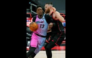 Miami Heat centre Bam Adebayo (13) crashes into Toronto Raptors centre Aron Baynes (46) during the first half of an NBA basketball game Wednesday, January 20, 2021, in Tampa, Florida.