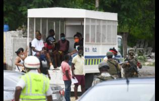 Police round up curfew breakers.