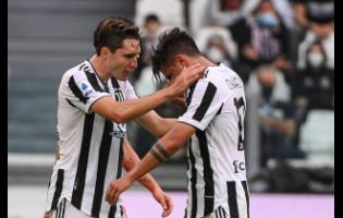 Juventus' Paulo Dybala (right) is consoled by teammate Federico Chiesa as he leaves the pitch after suffering an injury during the Italian Serie A  match between Juventus and Sampdoria, in Turin, Italy yesterday.