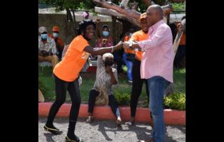 Deputy chairman of the People's National Party (PNP), Horace Dalley (right) raps with his Comrades at the party's headquarters at Old Hope Road in Kingston last Thursday. The party has been in turmoil since the general election loss last September. One of its members, Karen Cross, last week led a handful of disgruntled supporters to the party's headquarters to demand a change in its leadership.