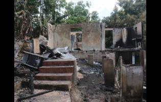 These houses were set ablaze in Granville, St. James, by hoodlums.