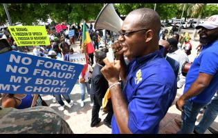 Joseph Patterson, of the United Independents' Congress, speaks during a march in downtown Kingston last Wednesday.