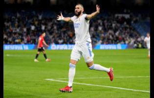 Real Madrid's Karim Benzema celebrates after scoring his team's fifth goal during a Spanish La Liga match between Real Madrid and Mallorca at the Bernabeu stadium in Madrid, Spain, Wednesday, September 22, 2021.