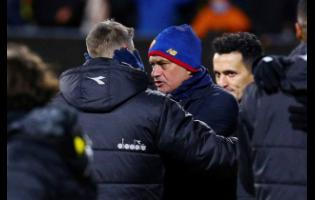 Bodo Glimt's coach Kjetil Knutsen (left) speaks with Roma's head coach Jose Mourinho (centre) after the Europa conference league match between Bodo Glimt and Roma at Aspmyra stadium in Bodo, Norway yesterday. Bodo Glimt won the match 6-1.