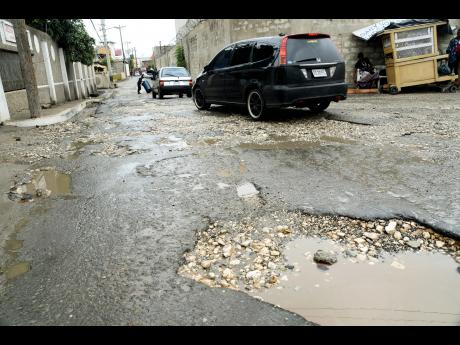 Jamaican potholes are like craters | Commentary | Jamaica Star