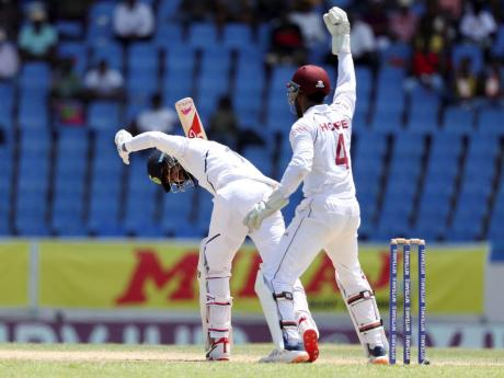 West Indies' Shai Hope celebrates the dismissal of India's KL Rahul during day one of the first Test cricket match at the Sir Vivian Richards cricket ground.