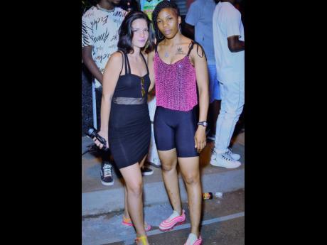 Marlene (left) and dancer Mara Jackhammer at Boom Sundayz held at Grants Pen Avenue, in St Andrew on Sunday.