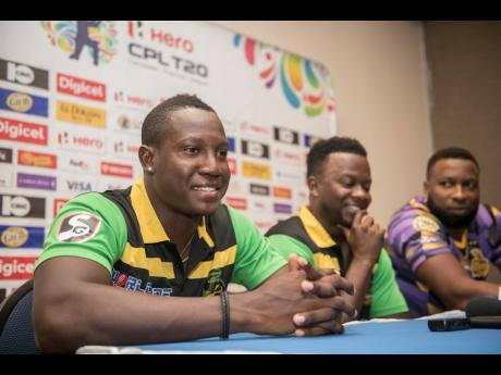 Jamaica Tallawahs acting captain Rovman Powell (left), head coach Donovan Miller (centre) and Trinbago Knight Riders captain Kieron Pollard address the media at a Caribbean Premier League press conference at The Jamaica Pegasus hotel yesterday.