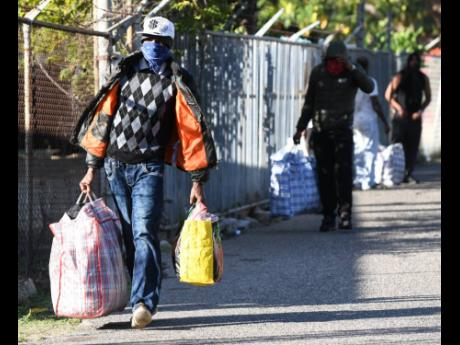 Deportees who arrived from United Kingdom on Tuesday make their way from Harman Barracks in Kingston, after being processed by the police.  A group of 17 convicted criminals were deported to the island. They were part of a group of 50 that the UK government intended to deport.  Some of these persons were stopped from boarding the flight due to a court ruling, but the British government says it intends to appeal the decision.