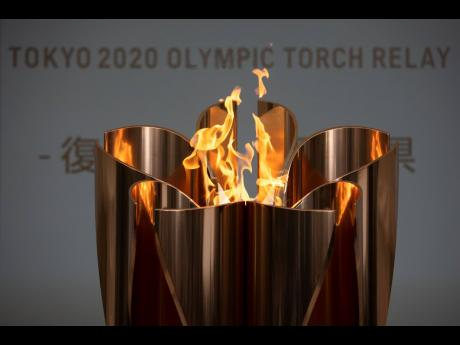 The Olympic Flame burns during a ceremony in Fukushima City, Japan, yesterday. The Tokyo Olympic torch relay will start on Thursday as planned in north-eastern Fukushima prefecture, but with no torch, no torch-bearers, no public, and little ceremony.