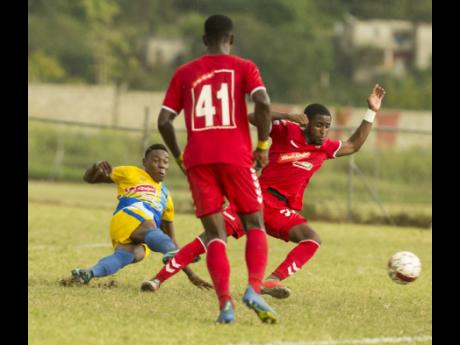 In this file photo from January 2019, Shemar Nairne (left), then of Harbour View, scores against UWI in a Red Stripe Premier League game at the UWI Mona Bowl.