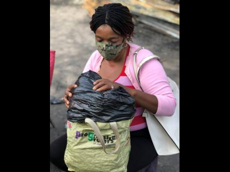 Aretha Bryan with all she has in her name, a plastic bag with clothes she received from her sister.