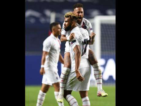 PSG's Neymar celebrates with teammate Eric Maxim Choupo-Moting after his team's win in the Champions League quarter-final match between Atalanta and PSG at Luz stadium, Lisbon, Portugal, yesterday. PSG won 2-1.