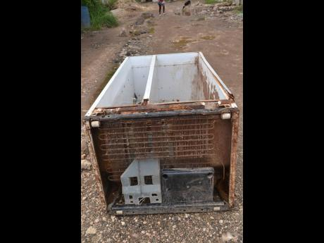 This is one of the old fridges that Harris says was washed into her yard.