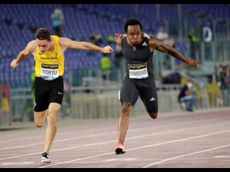 South Africa's Akani Simbine (right) wins in 9.96 seconds the men's 100m competition at the Golden Gala Pietro Mennea IAAF Diamond League athletics meet in Rome yesterday.