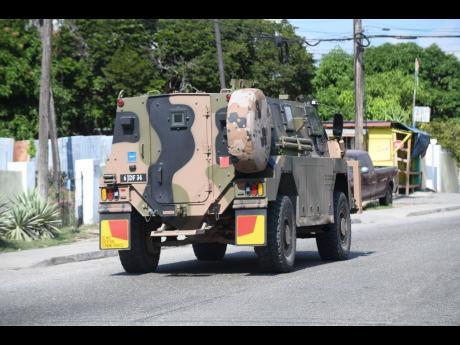 A JDF tank patrols the streets of Kingston.