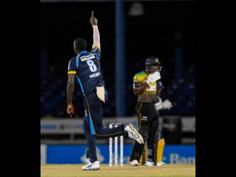 FILE  Jason Holder (left) of Barbados Tridents celebrates the dismissal of Rovman Powell (right) of Jamaica Tallawahs in the Hero Caribbean Premier League match at Queen's Park Oval in Port of Spain, Trinidad and Tobago, in August.